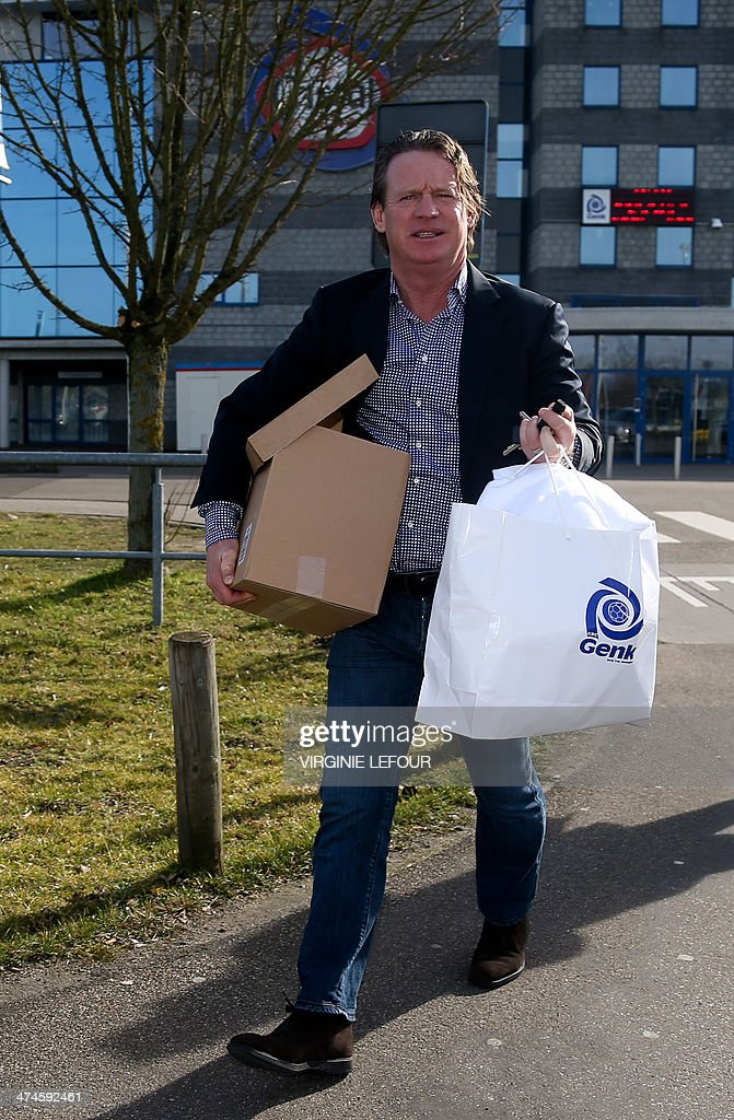 Genk's head coach Mario Been leaves with a box and a bag after a press conference of Genk first division soccer club on February 24, 2014 , after the club announced the end of the contract with their head coach after the fifth game lost in their stadium, in Genk.