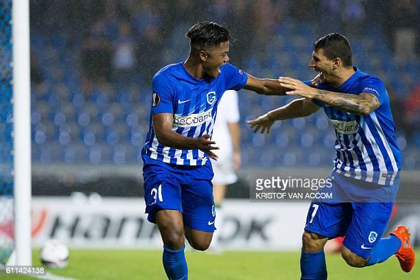 Genk's Jamaican forward Leon Bailey and Genk's Greek forward Nikolaos Karelis celebrate after scoring a goal during the UEFA Europa League football...