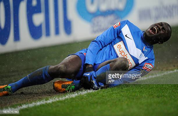 Genk's Kara Mbodj holds his leg during the Jupiler Pro League match between Standard de Liege and RC Genk in Liege on February 24 during the Belgian...