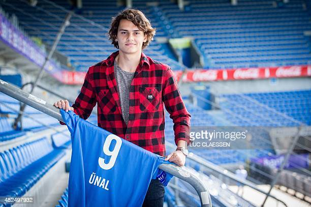 Genk's new player Enes Unal of Turkey poses for the photographer with his jersey after a press conference of Belgian first division soccer team KRC...