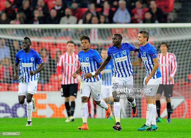 Genk's Nigerian midfielder Wilfred Ndidi is congratulated by teammates Jamaican midfielder Leon Bailey and defender Timoty Castagne after scoring his...