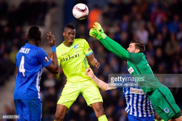 Genk's Omar Colley Gent's Kalifa Coulibaly and Genk's goalkeeper Mathew Ryan vie for the ball during UEFA Europa League football match between Genk...
