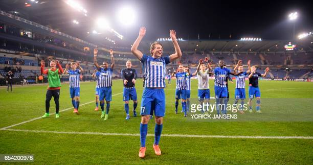 Genk's Sander Berge celebrates with teammates after winning the UEFA Europa League football match between Genk and Gent on March 16 2017 in Genk /...