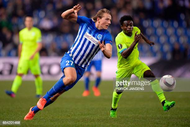 Genk's Sander Berge vies with Gent's Moses Simon during UEFA Europa League football match between Genk and Gent on March 16 2017 in Genk / AFP PHOTO...