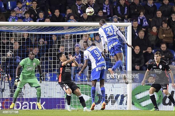 Genk's Sekou Cisse is seen in action in the air in front of Standard's goalkeeper Yohann Thuram during the Jupiler Pro League match between KRC Genk...