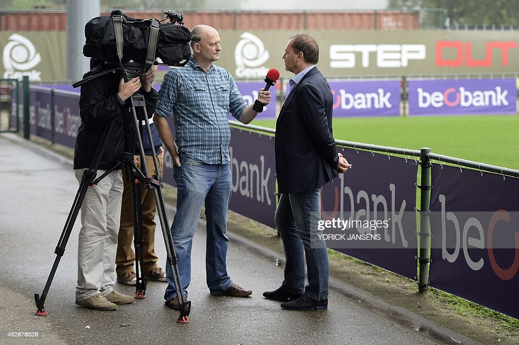 Genk's technical director Gunther Jacob speaks to the press at the stadium of Belgian football team KRC Genk, in Genk, Belgium, on July 29, 2014. Genk announced the dismissal of head coach Emilio Ferrera on July 29, after Ferrera coached the team for only one Jupiler League match.