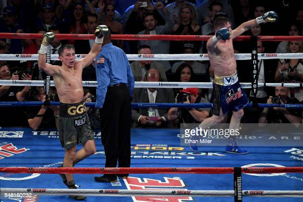 Gennady Golovkin and Canelo Alvarez both celebrate after the final round in their WBC WBA and IBF middleweight championship bout at TMobile Arena on...