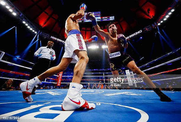 Gennady Golovkin exchanges punches with David Lemieux during their WBA/WBC interim/IBF middleweight title unification bout at Madison Square Garden...