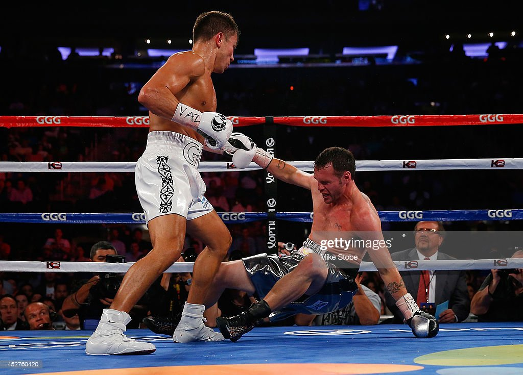 <a gi-track='captionPersonalityLinkClicked' href=/galleries/search?phrase=Gennady+Golovkin&family=editorial&specificpeople=10619206 ng-click='$event.stopPropagation()'>Gennady Golovkin</a> knocks out <a gi-track='captionPersonalityLinkClicked' href=/galleries/search?phrase=Daniel+Geale&family=editorial&specificpeople=2229560 ng-click='$event.stopPropagation()'>Daniel Geale</a> in the third round to win the WBA/IBO middleweight championship at Madison Square Garden on July 26, 2014 in New York City.