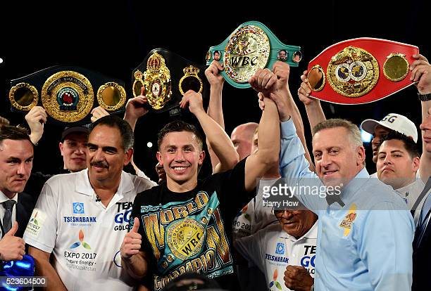 Gennady Golovkin of Kazakhstan poses with his belts after his second round TKO of Dominic Wade during a unified middleweight title fight at The Forum...