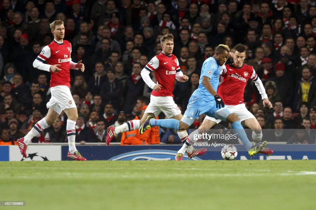 Gennaro Bracigliano of Marseille (2nd R) vies for the ball during the UEFA Champions League group F football match between Arsenal and Olympique de Marseille at the Emirates Stadium on November 26, 2013 in London, England.
