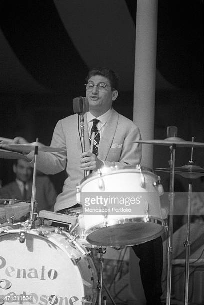 Gennaro Di Giacomo known as Gege the alter ego friend and drummer of Renato Carosone playing the drums keenly during an open air show together with...