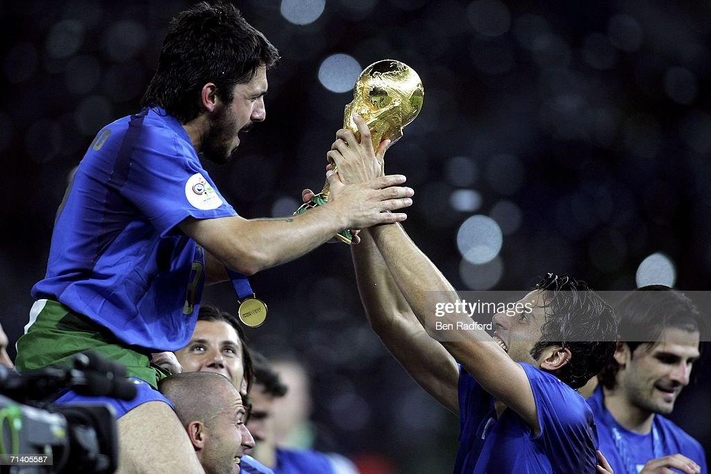 Gennaro Gattuso (L) and Fabio Grosso (R) of Italy celebrate with the world cup trophy during the FIFA World Cup Germany 2006 Final match between Italy and France at the Olympic Stadium on July 9, 2006 in Berlin, Germany.