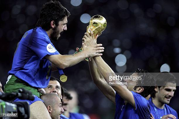 Gennaro Gattuso and Fabio Grosso of Italy celebrate with the world cup trophy during the FIFA World Cup Germany 2006 Final match between Italy and...