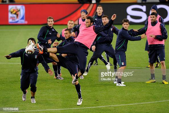 Gennaro Gattuso and Giampaolo Pazzini fight for the ball during an Italian training session at the 2010 FIFA World Cup at Green Point stadium on June...