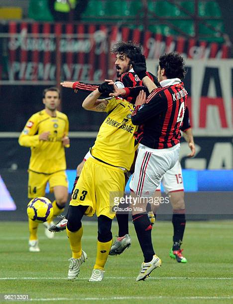 Gennaro Gattuso and Kakha Kaladze of AC Milan competes for the ball with Antonio Floro Flores of Udinese Calcio during the Tim Cup match between...
