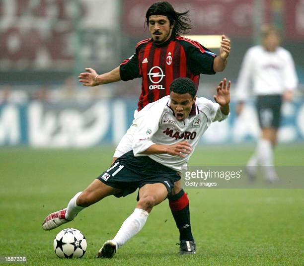 Gennaro Gattuso of AC Milan and Julio Cesar Leon of Reggina in action during the Serie A match between AC MIlan and Reggina played at the 'Giuseppe...