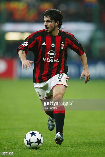 Gennaro Gattuso of AC Milan runs with the ball during the UEFA Champions League Quarter Final First Leg match between AC Milan and Deportivo La...