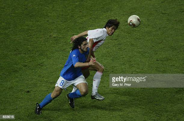 Gennaro Gattuso of Italy and Ki Hyeon Seol of South Korea fight for the ball during the FIFA World Cup Finals 2002 Second Round match played at the...