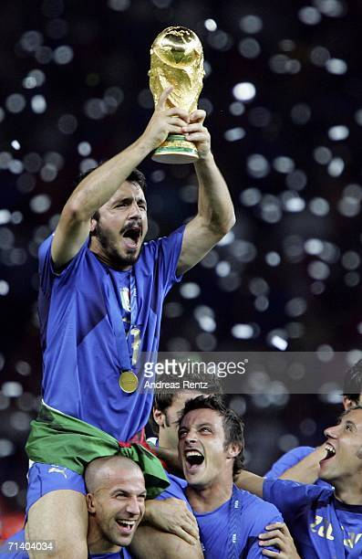 Gennaro Gattuso of Italy holds aloft the world cup trophy after the FIFA World Cup Germany 2006 Final match between Italy and France at the Olympic...
