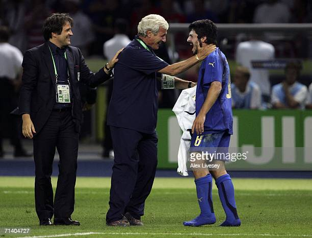 Gennaro Gattuso of Italy is congratulated by Marcello Lippi the coach of Italy following their team's victory during the FIFA World Cup Germany 2006...