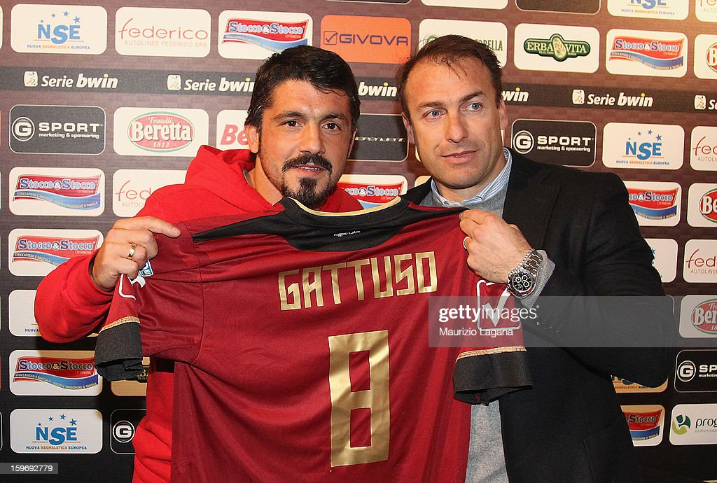 <a gi-track='captionPersonalityLinkClicked' href=/galleries/search?phrase=Gennaro+Gattuso&family=editorial&specificpeople=210827 ng-click='$event.stopPropagation()'>Gennaro Gattuso</a> of Sion and Simone Giacchetta sporting director of Reggina pose showing Reggina Calcio shirt before the friendly match between Reggina Calcio and FC Sion on January 18, 2013 in Reggio Calabria, Italy.
