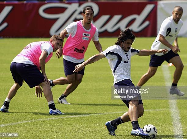 Gennaro Gattuso shoots on goal as Francesco Totti Mauro Camoranesi and Alessandro Del Piero look on during an Italy training session on June 19 2006...