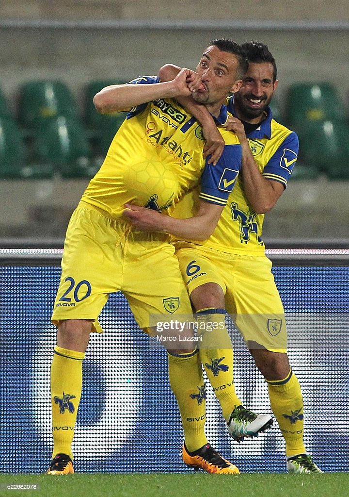 Gennaro Sardo (L) of AC Chievo Verona celebrates his goal with his team-mate <a gi-track='captionPersonalityLinkClicked' href=/galleries/search?phrase=Giampiero+Pinzi&family=editorial&specificpeople=2164981 ng-click='$event.stopPropagation()'>Giampiero Pinzi</a> (R) during the Serie A match between AC Chievo Verona and Frosinone Calcio at Stadio Marc'Antonio Bentegodi on April 20, 2016 in Verona, Italy.