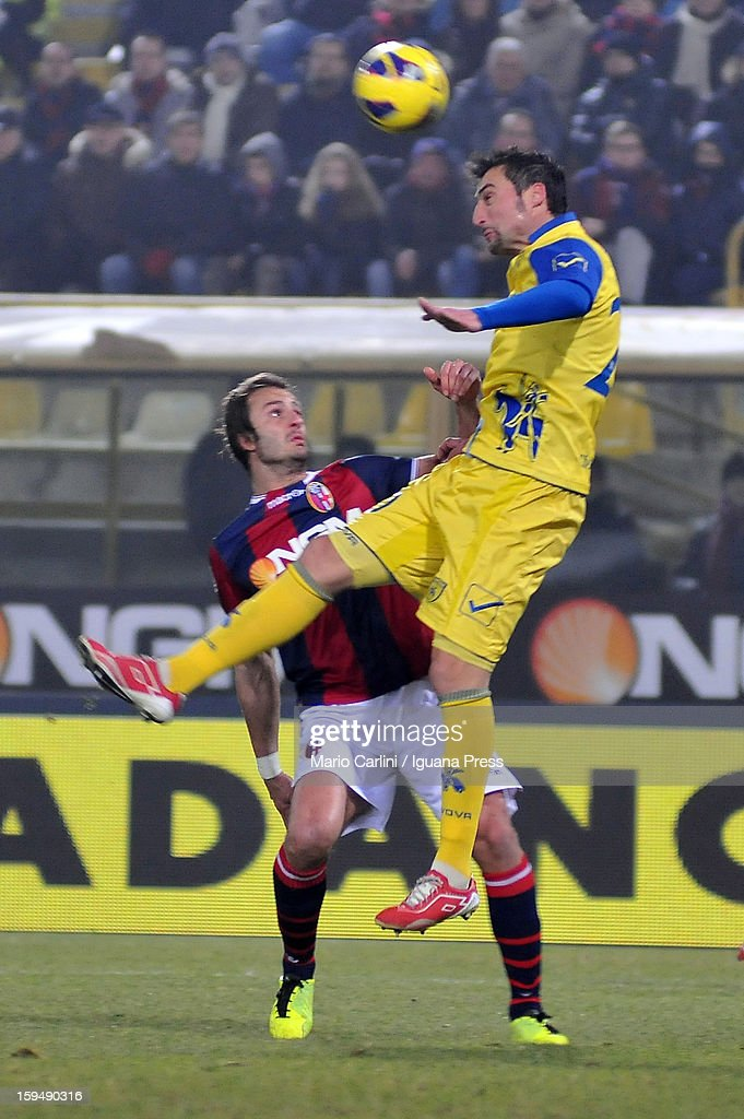 Gennaro Sardo (R) of AC Chievo Verona heads the ball as <a gi-track='captionPersonalityLinkClicked' href=/galleries/search?phrase=Alberto+Gilardino&family=editorial&specificpeople=215491 ng-click='$event.stopPropagation()'>Alberto Gilardino</a> of Bologna FC makes a challenge during the Serie A match between Bologna FC and AC Chievo Verona at Stadio Renato Dall'Ara on January 12, 2013 in Bologna, Italy.