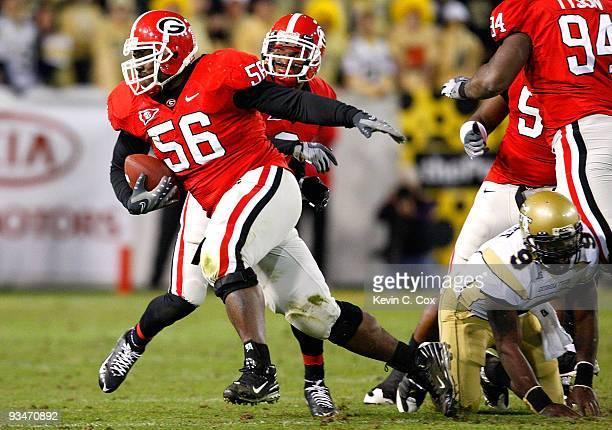 Geno Atkins of the Georgia Bulldogs scoops up a fumble by quarterback Josh Nesbitt of the Georgia Tech Yellow Jackets at Bobby Dodd Stadium on...