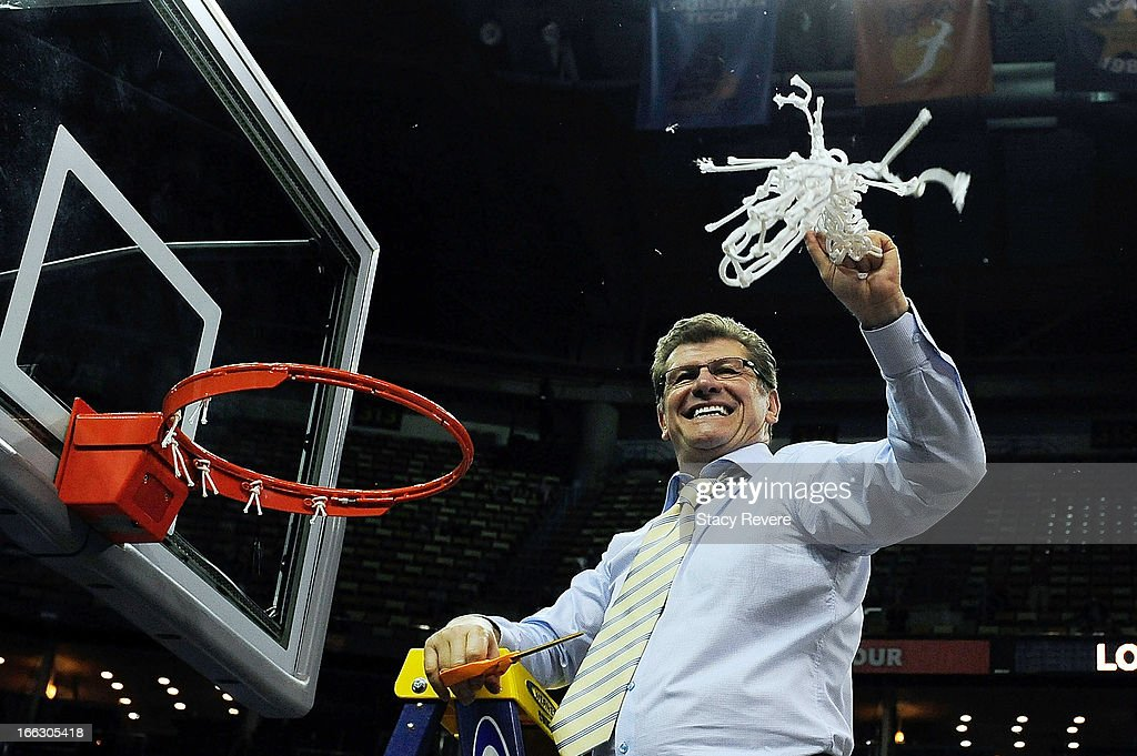 Geno Auriemma, head coach of the Connecticut Huskies, cuts down the net following a victory over the Louisville Cardinals in the National Final game of the 2013 NCAA Division I Women's Basketball Championship at New Orleans Arena on April 9, 2013 in New Orleans, Louisiana.