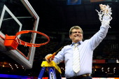 Geno Auriemma head coach of the Connecticut Huskies cuts down the net following a victory over the Louisville Cardinals in the National Final game of...