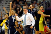 Geno Auriemma head coach of the Connecticut Huskies reacts to a three point shot against the Notre Dame Fighting Irish during the National Semifinal...