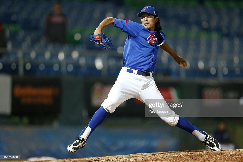 Geno Espineli #42 of Team Philippines pitches during Game 5 of the 2013 World Baseball Classic Qualifier against Team New Zealand at Xinzhuang Stadium in New Taipei City, Taiwan on Saturday, November 17, 2012.