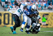 Geno Hayes of the Jacksonville Jaguars attempts to tackle Trent Richardson of the Indianapolis Colts during the game at EverBank Field on September...