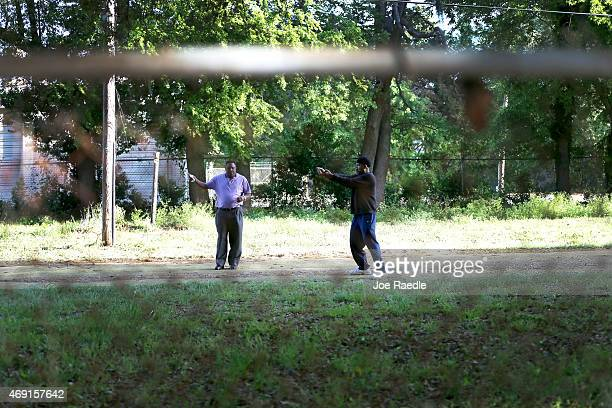 Geno Jones demonstrates to the Rev Larry Bratton how he thinks the North Charleston police officer shot and killed Walter Scott as they visit the...