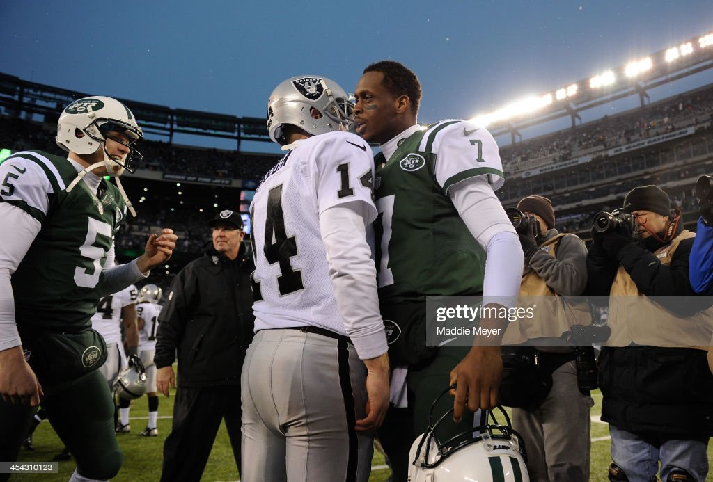 <a gi-track='captionPersonalityLinkClicked' href=/galleries/search?phrase=Geno+Smith&family=editorial&specificpeople=6379793 ng-click='$event.stopPropagation()'>Geno Smith</a> #7 of the New York Jets and <a gi-track='captionPersonalityLinkClicked' href=/galleries/search?phrase=Matt+McGloin&family=editorial&specificpeople=7301322 ng-click='$event.stopPropagation()'>Matt McGloin</a> #14 of the Oakland Raiders talk after their game at MetLife Stadium on December 8, 2013 in East Rutherford, New Jersey. The Jets defeat the Raiders 37-27.