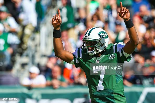 Geno Smith of the New York Jets celebrates after throwing a touchdown pass to teammate Jace Amaro in the first quarter during a game against the...