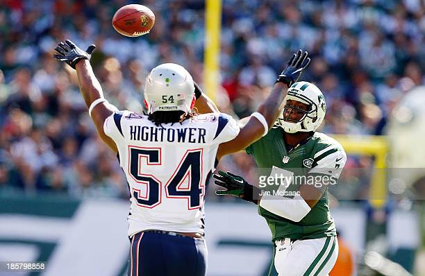 Geno Smith of the New York Jets in action against Dont'a Hightower of the New England Patriots on October 20 2013 at MetLife Stadium in East...