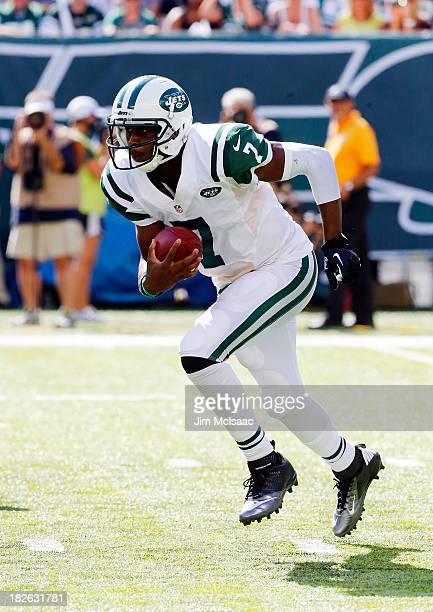 Geno Smith of the New York Jets in action against the Tampa Bay Buccaneers on September 8 2013 at MetLife Stadium in East Rutherford New Jersey The...