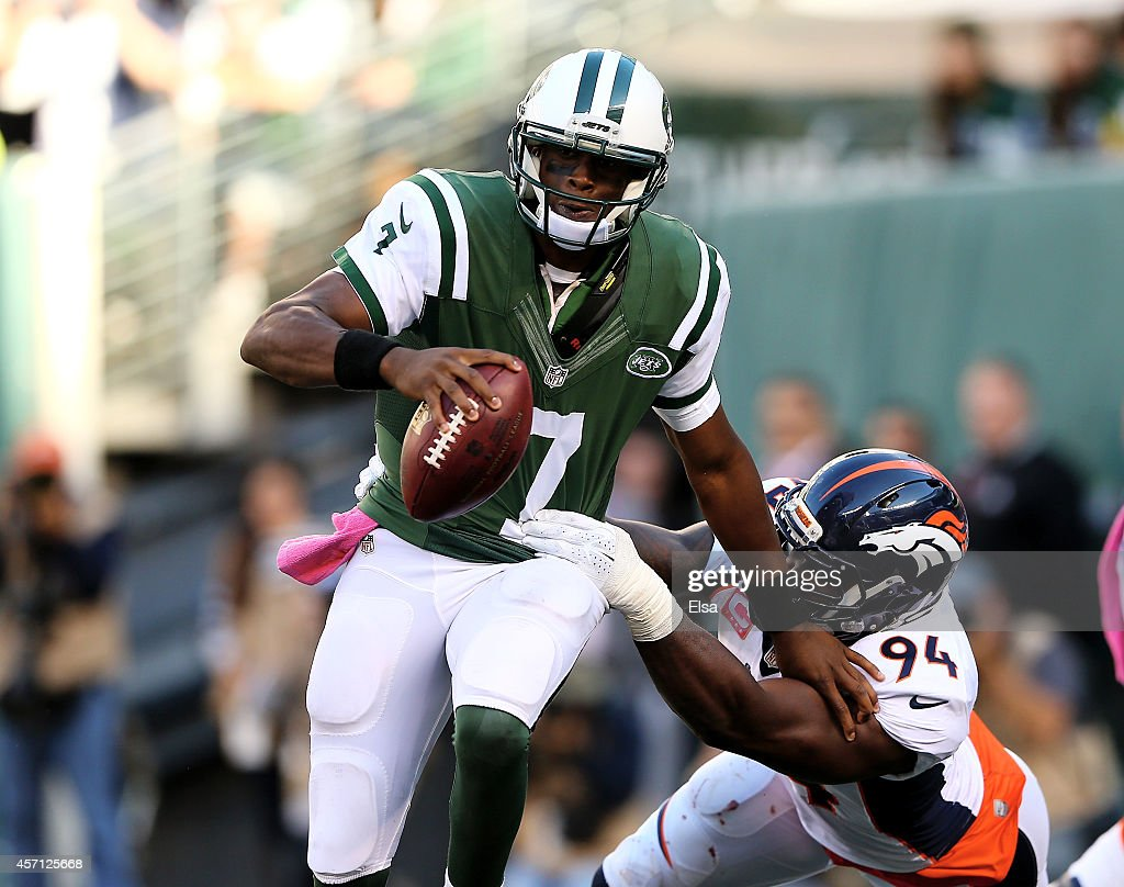 Geno Smith #7 of the New York Jets is sacked by DeMarcus Ware #94 of the Denver Broncos in the fourth quarter on October 12, 2014 at MetLife Stadium in East Rutherford, New Jersey.