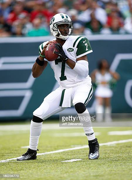 Geno Smith of the New York Jets looks for an open man against the Tampa Bay Buccaneers during their game at MetLife Stadium on September 8 2013 in...