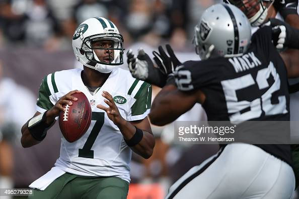 Geno Smith of the New York Jets looks to pass against the Oakland Raiders during their NFL game at Oco Coliseum on November 1 2015 in Oakland...