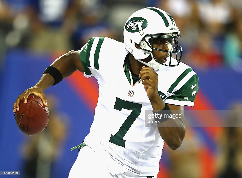 Geno Smith #7 of the New York Jets passes against the New York Giants during their pre season game at MetLife Stadium on August 24, 2013 in East Rutherford, New Jersey.