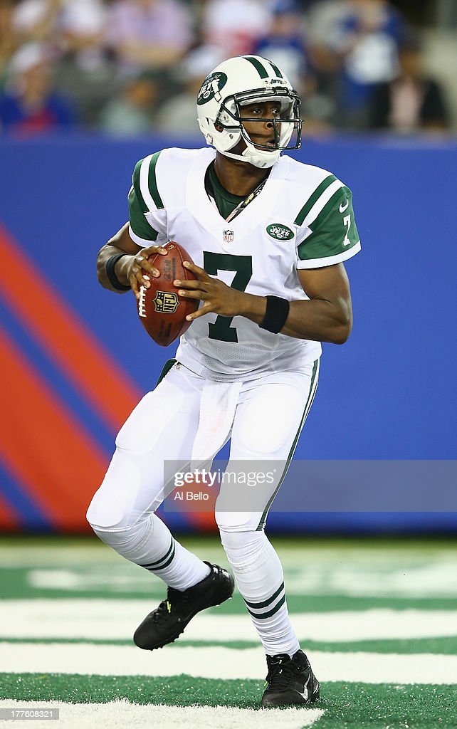 <a gi-track='captionPersonalityLinkClicked' href=/galleries/search?phrase=Geno+Smith&family=editorial&specificpeople=6379793 ng-click='$event.stopPropagation()'>Geno Smith</a> #7 of the New York Jets passes against the New York Giants during their pre season game at MetLife Stadium on August 24, 2013 in East Rutherford, New Jersey.