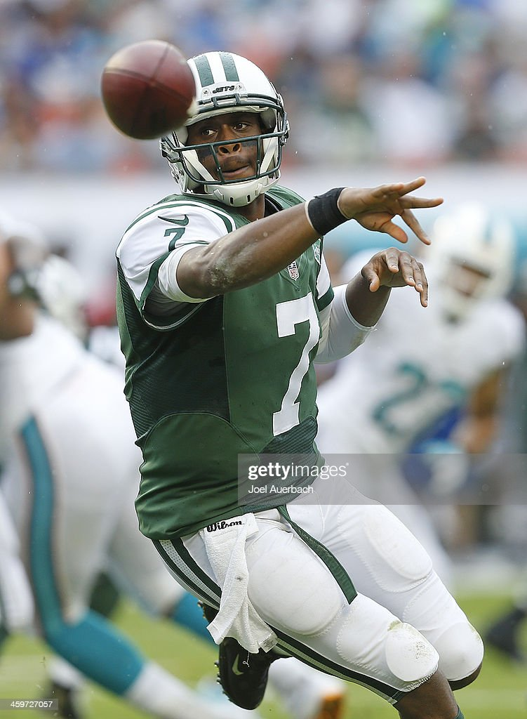 <a gi-track='captionPersonalityLinkClicked' href=/galleries/search?phrase=Geno+Smith&family=editorial&specificpeople=6379793 ng-click='$event.stopPropagation()'>Geno Smith</a> #7 of the New York Jets pitches the ball to Bilal Powell #29 during first quarter action against the Miami Dolphins on December 29, 2013 at Sun Life Stadium in Miami Gardens, Florida.