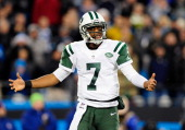 Geno Smith of the New York Jets reacts after being called for a delay of game penalty during a loss to the Carolina Panthers at Bank of America...
