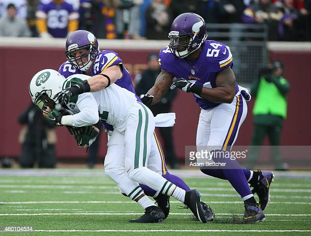 Geno Smith of the New York Jets recovers a fumble but gets sacked by Chad Greenway and Jasper Brinkley of the Minnesota Vikings in the first quarter...