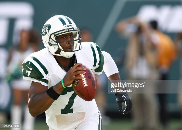 Geno Smith of the New York Jets rolls out against the Tampa Bay Buccaneers during their game at MetLife Stadium on September 8 2013 in East...