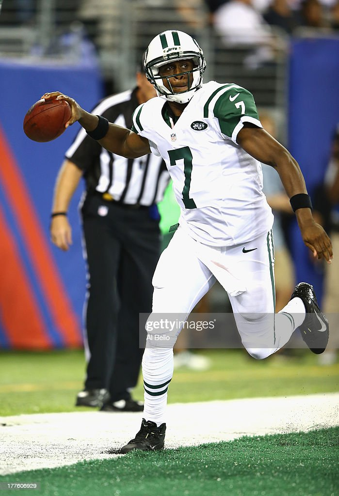 <a gi-track='captionPersonalityLinkClicked' href=/galleries/search?phrase=Geno+Smith&family=editorial&specificpeople=6379793 ng-click='$event.stopPropagation()'>Geno Smith</a> #7 of the New York Jets runs out of the end zone giving up a safety against the New York Giants during their pre season game at MetLife Stadium on August 24, 2013 in East Rutherford, New Jersey.